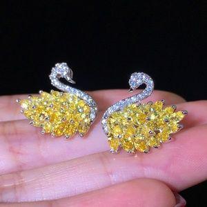 Jewelry - STUNNING Swan faux 925 Silver earrings_yellow